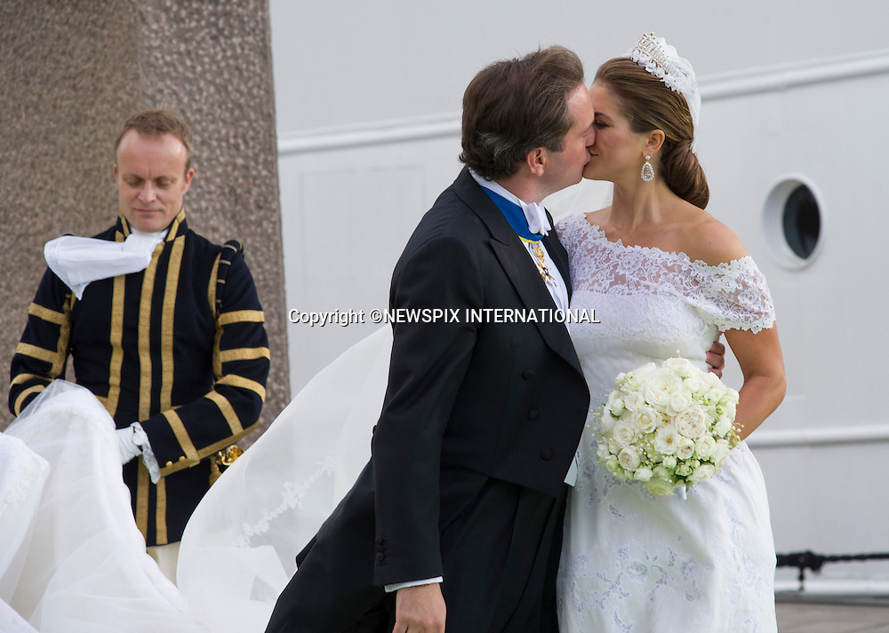 PRINCESS MADELEINE AND CHRISTOPHER O'NEILL KISS<br /> The Bridal Couple and Guests arrive for a boat ride to Drottingholm Palace for the Wedding Banquet Riddarholmen, Stockholm, Sweden_08/06/2013<br /> Mandatory Credit Photo: &copy;Francis Dias/NEWSPIX INTERNATIONAL<br /> <br /> **ALL FEES PAYABLE TO: &quot;NEWSPIX INTERNATIONAL&quot;**<br /> <br /> IMMEDIATE CONFIRMATION OF USAGE REQUIRED:<br /> Newspix International, 31 Chinnery Hill, Bishop's Stortford, ENGLAND CM23 3PS<br /> Tel:+441279 324672  ; Fax: +441279656877<br /> Mobile:  07775681153<br /> e-mail: info@newspixinternational.co.uk