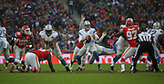 Detroit Lions Matthew Stafford trying to find a pass whilst chaos around him ensues during the Kansas City Chiefs v Detroit Lions  NFL International Series match at Wembley Stadium, London, England on 1 November 2015. Photo by Matthew Redman.