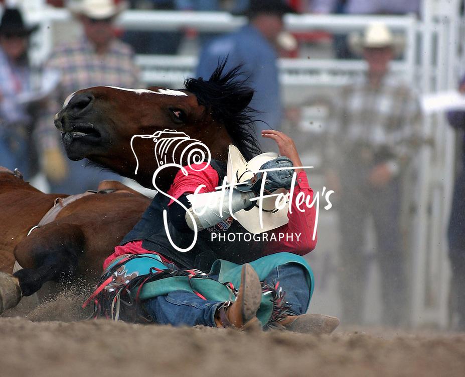 Cowboy in trouble, 2004 Cheyenne Frontier Days Rodeo, Cheyenne WY, July 2004