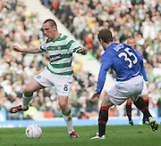 Scott Brown on the ball as Steven Davis watches during the League Cup final between Rangers and Celtic at Hampden Park -<br /> David Young