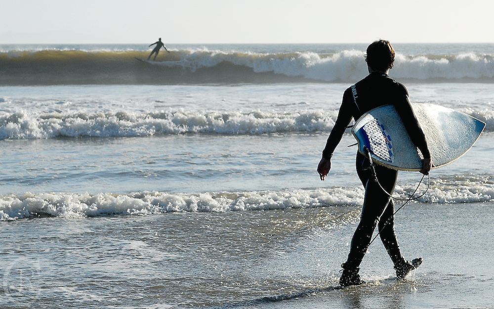 A local surfer gets ready to catch a wave at Surfer's Point in Ventura, California.