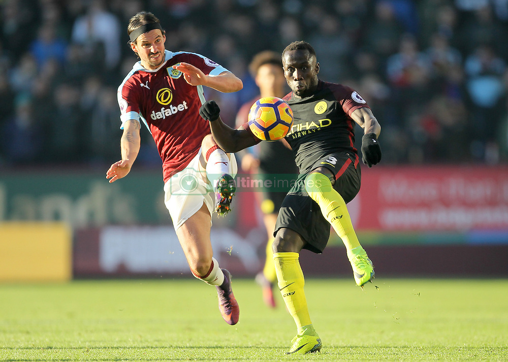 Burnley's George Boyd (left) and Manchester City's Bacary Sagna (right) battle for the ball