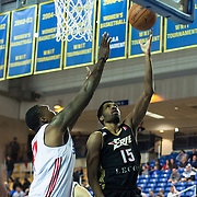 "Erie BayHawks Guard Scott Suggs (15) drive toward the basket as Delaware 87ers Forward Keith ""Tiny"" Gallon (41) defends in the first half of a NBA D-league regular season basketball game between Delaware 87ers (76ers) and the Erie BayHawks (Knicks) Friday, Jan. 3, 2014 at The Bob Carpenter Sports Convocation Center, Newark, DE"