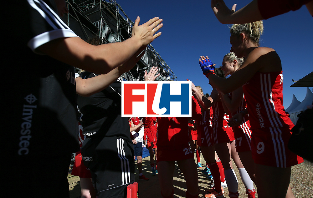 JOHANNESBURG, SOUTH AFRICA - JULY 16:  Lily Owsley of England celebrates her 100 caps with team mates during day 5 of the FIH Hockey World League Women's Semi Finals Pool A match between England and Ireland at Wits University on July 16, 2017 in Johannesburg, South Africa.  (Photo by Jan Kruger/Getty Images for FIH)