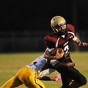 Ashley High School's Cham Carey is tackled by Fairmont High School's Raquan Moore Friday September 5, 2014 in Wilmington, N.C. (Jason A. Frizzelle)
