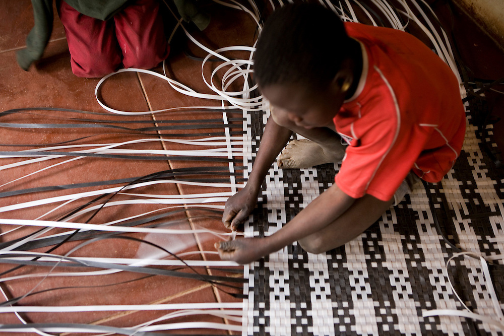 The Streets Ahead organisation has created some income generating activities for the children living on the streets of Harare, Zimbabwe. Here they are making mats out of bits of plastic. Streets Ahead is a welfare organisation that works with underprivileged children living on the streets of Harare.