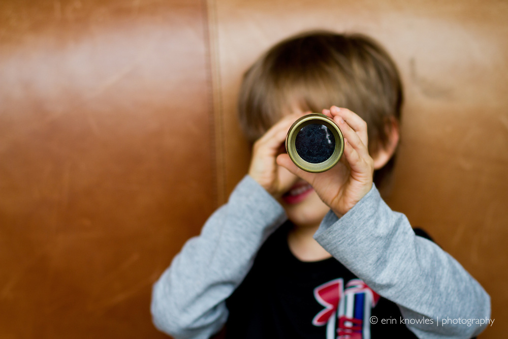 Child with spyglass.