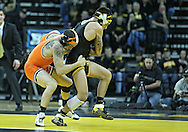 January 07, 2011: Oklahoma State's Jordan Oliver tries to score a takedown on Iowa's Tony Ramos battle during the 133-pound bout in the NCAA wrestling dual between the Oklahoma State Cowboys and the Iowa Hawkeyes at Carver-Hawkeye Arena in Iowa City, Iowa on Saturday, January 7, 2012. Ramos won 4-3.