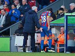 LONDON, ENGLAND - Saturday, February 21, 2015: Crystal Palace's Joe Ledley gets a pat on the bum from manager Alan Pardew as he is substituted during the Premier League match against Arsenal at Selhurst Park. (Pic by David Rawcliffe/Propaganda)