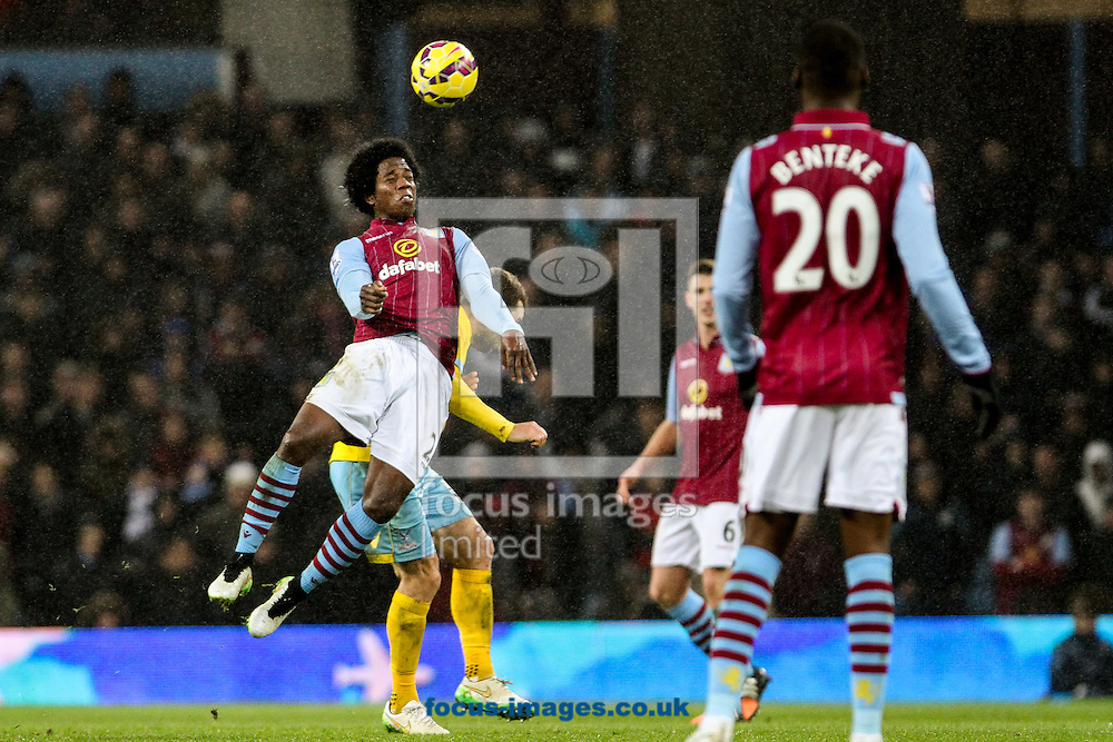 Carlos Sanchez of Aston Villa (left) heads at goal during the Barclays Premier League match at Villa Park, Birmingham<br /> Picture by Andy Kearns/Focus Images Ltd 0781 864 4264<br /> 01/01/2015