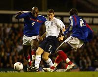 Photo: Chris Ratcliffe.<br /> England v France. U21 European Championships.<br /> 11/11/2005.<br /> James Milner gets in between Ronald Zubar left and Bakari Sagna of France