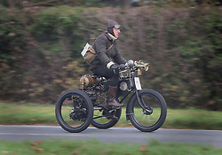© Licensed to London News Pictures. 01/11/2015. Staplefield, UK. A 1901 De Dion Bouton Tricycle passes through Staplefield as it takes part in the London to Brighton Veteran Car Run.  Photo credit: Peter Macdiarmid/LNP