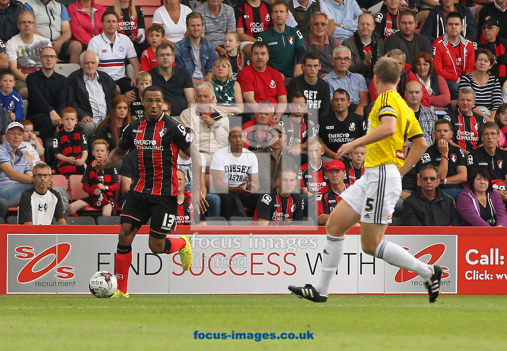 Callum Wilson (left) of Bournemouth and Tony Craig (right) of Brentford during the Sky Bet Championship match at the Goldsands Stadium, Bournemouth<br /> Picture by Tom Smith/Focus Images Ltd 07545141164<br /> 16/08/2014
