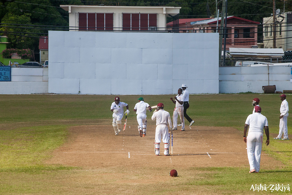 Windward Islands Volcanoes batsman Liam Sebastien (left) and Kavem Hodge (second from left) take a run during play against Leeward Islands Hurricanes on the third day of the seventh round match in the WICB Professional Cricket League Regional 4-Day Tournament on Sunday, February 21, 2016 at the Addelita Cancryn Junior High School.<br /> <br /> &copy; Aisha-Zakiya Boyd