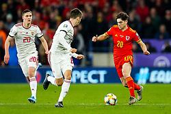 Daniel James of Wales is challenged by Adam Nagy of Hungary - Rogan/JMP - 19/11/2019 - FOOTBALL - Cardiff City Stadium - Cardiff, Wales - Wales v Hungary - UEFA Euro 2020 Qualifiers.