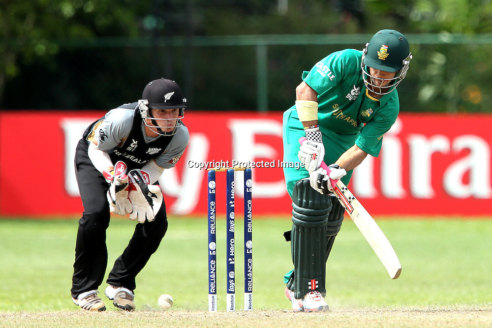 BJ Watling keeps wicket as AB de Villiers bats during the ICC Twenty 20 World Cup warm up match between New Zealand and South Africa held at the Colts Cricket Club in Colombo, Sri Lanka on the 17th September 2012<br /> <br /> Photo by Ron Gaunt/SPORTZPICS/PHOTOSPORT