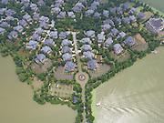 WUHAN, CHINA - JULY 08:<br />  Luxury villas on a little island are surrounded by floodwaters on July 8, 2016 in Wuhan, Hubei Province of China. Every villa is priced at 80 million yuan (11.98 million U.S. dollars). Wuhan Meteorological Observatory has issued red alert to continuous torrential rain on early Wednesday as parts of central city and surrouding villages have flooded. ©Exclusivepix Media