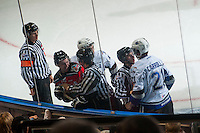KELOWNA, CANADA - NOVEMBER 5: Referee Kevin Bennett stands on the ice as linesman Kevin Crowell and Dave McMahon get in between Colten Martin #8 of Kelowna Rockets and Austin Carroll #21 of Victoria Royals on November 5, 2014 at Prospera Place in Kelowna, British Columbia, Canada.  (Photo by Marissa Baecker/Shoot the Breeze)  *** Local Caption *** Kevin Bennett; Kevin Crowell; Dave McMahon; Colten Martin; Austin Carroll;