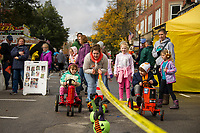 Hiller Orthodontists brought the tractor pull to Main St during Pumpkin Fest Saturday afternoon.  Persiphone and Isaac Renn go head to head down the track.  (Karen Bobotas/for the Laconia Daily Sun)