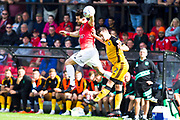 Salford City midfielder Richie Towell and Port Vale defender Leon Legge in areal challenge during the EFL Sky Bet League 2 match between Salford City and Port Vale at Moor Lane, Salford, United Kingdom on 17 August 2019.
