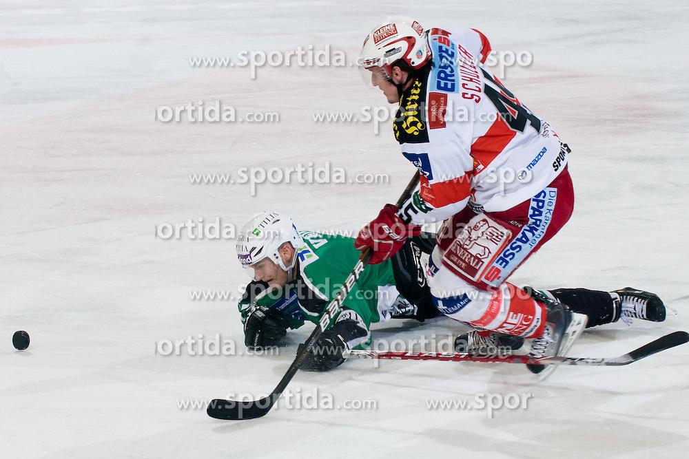 David Schuller (EC KAC, #45) vs Domen Vedlin (HDD Tilia Olimpija, #7) during ice-hockey match between HDD Tilia Olimpija and EC KAC in 32nd Round of EBEL league, on December 30, 2010 at Hala Tivoli, Ljubljana, Slovenia. (Photo By Matic Klansek Velej / Sportida.com)