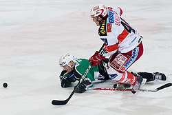 David Schuller (EC KAC, #45) vs Domen Vedlin (HDD Tilia Olimpija, #7) during ice-hockey match between HDD Tilia Olimpija and EC KAC in 32nd Round of EBEL league, on December 30, 2010 at Hala Tivoli, Ljubljana, Slovenia. (Photo By Matic Klansek Velej / Sportida.com)
