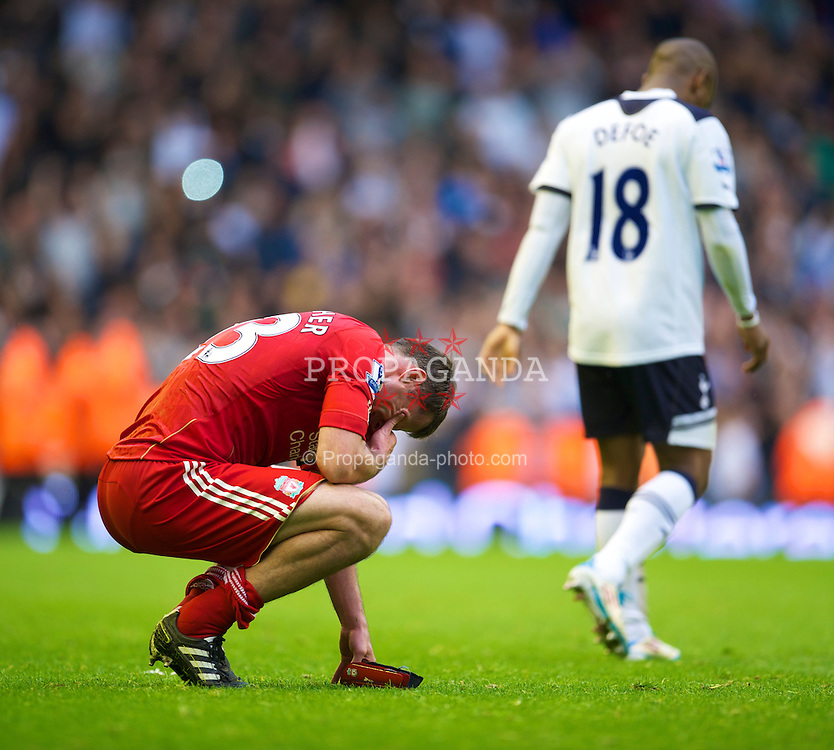 LIVERPOOL, ENGLAND - Sunday, May 15, 2011: Liverpool's Jamie Carragher looks dejected after a 2-0 defeat to Tottenham Hotspur during the Premiership match at Anfield. (Photo by David Rawcliffe/Propaganda)