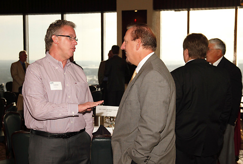 Craig Randall of tw telecom (left) and Dennis Swearingen of Sequent during the Dayton Area Chamber of Commerce Breakfast Briefing at the Dayton Racquet Club in downtown Dayton, Friday, July 13, 2012.