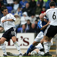 St Johnstone v Dundee...17.09.05<br />Darren Sheridan is taken out by Dundee's Barry Smith, Steven Craig and Scott Robertson<br /><br />Picture by Graeme Hart.<br />Copyright Perthshire Picture Agency<br />Tel: 01738 623350  Mobile: 07990 594431