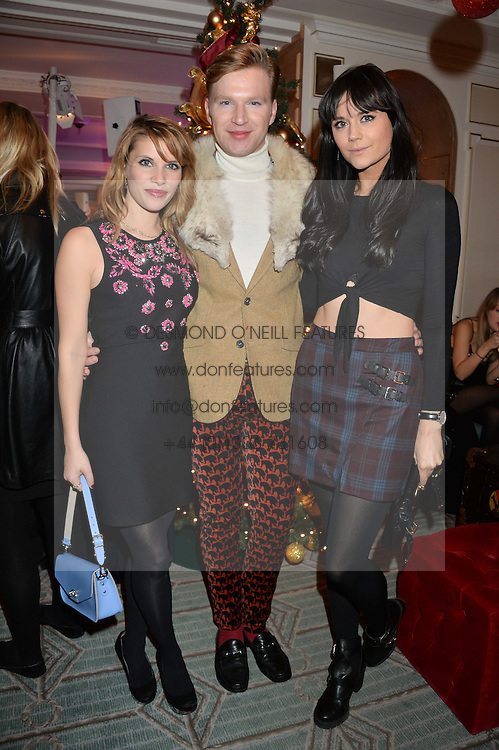 Left to right, PIPS TAYLOR, HENRY TAYLOR and LILAH PARSONS at the Fortnum & Mason and Quintessentially Foundation Fayre of St.James's in association with The Crown Estate held at St.James's Church, Piccadilly followed but a reception at Fortnum & Mason, Piccadilly,London on 5th December 2013.