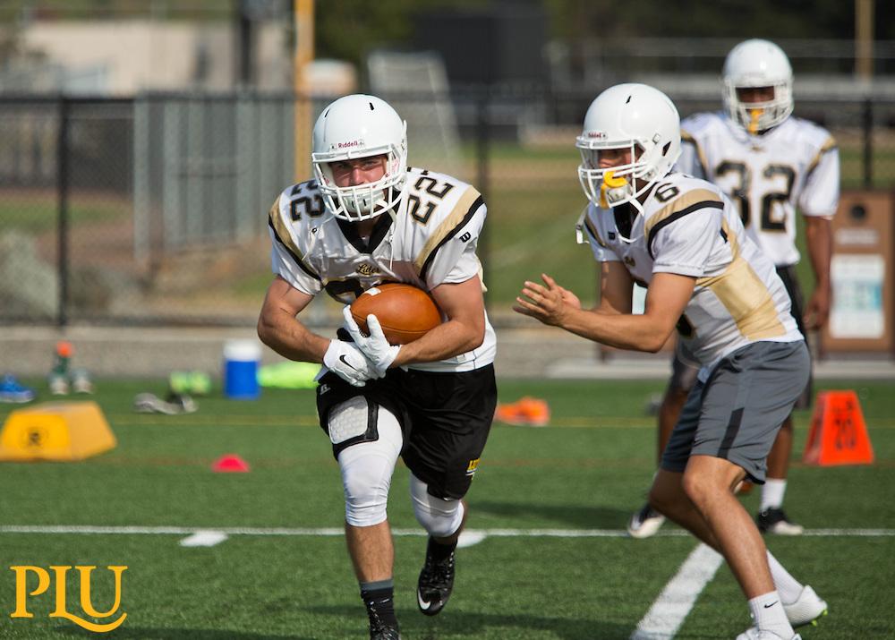 Start of football practice at PLU on Thursday, Aug. 27, 2015. (Photo: John Froschauer/PLU)