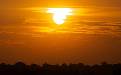 ©Licensed to London News Pictures 10/08/2020   Orpington, UK. The sun sets this evening over Orpington in South East London on another heatwave day in the UK. Photo credit: Grant Falvey/LNP