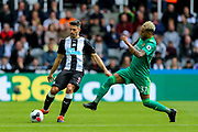 Fabian Schar (#5) of Newcastle United plays a long pass under pressure from Roberto Pereyra (#37) of Watford during the Premier League match between Newcastle United and Watford at St. James's Park, Newcastle, England on 31 August 2019.