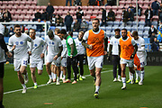 Leeds United warming up during the EFL Sky Bet Championship match between Wigan Athletic and Leeds United at the DW Stadium, Wigan, England on 4 November 2018.