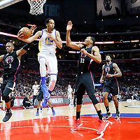 20 February 2016: Golden State Warriors guard Shaun Livingston (34) passes the ball past Los Angeles Clippers guard Chris Paul (3) and Los Angeles Clippers forward Wesley Johnson (33) during the Golden State Warriors 115-112 victory over the Los Angeles Clippers, at the Staples Center, Los Angeles, California, USA.