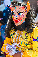 Pisac, Peru - July 16, 2013: masked woman portrait at Virgen del Carmen parade in the peruvian Andes at Pisac Peru on july 16th, 2013