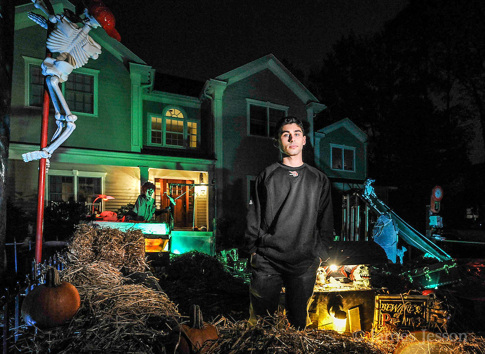 John Downs, a WHS grad and sophomore at UNH studying engineering, has been designing elaborate Halloween displays in the front yard of his home on Franklin Road in Winchester for the past ten years.  John was inspired by similar displays put on in his neighborhood that he adored as a child.   Wicked Local Photo/James Jesson