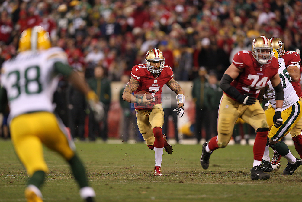 San Francisco 49ers quarterback Colin Kaepernick (7) runs during a NFL Divisional playoff game against the Green Bay Packers at Candlestick Park in San Francisco, Calif., on Jan. 12, 2013. The 49ers defeated the Packers 45-31. (AP Photo/Jed Jacobsohn)