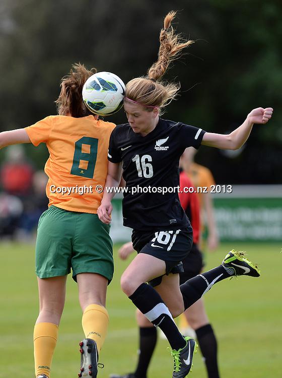 Tayla O'Brien (16) collides with Australia's Natalie Tobin. New Zealand Junior Football Ferns v Australia Young Matildas. Women's U20 International. Kiwitea St, Auckland. Saturday 27 July 2013. Photo: Andrew Cornaga/www. Photosport.co.nz