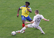 Juan Carlos Paredes of Ecuador (L) goes past Lucas Digne of France during the 2014 FIFA World Cup Group E match at Maracana Stadium, Rio de Janeiro<br /> Picture by Andrew Tobin/Focus Images Ltd +44 7710 761829<br /> 25/06/2014