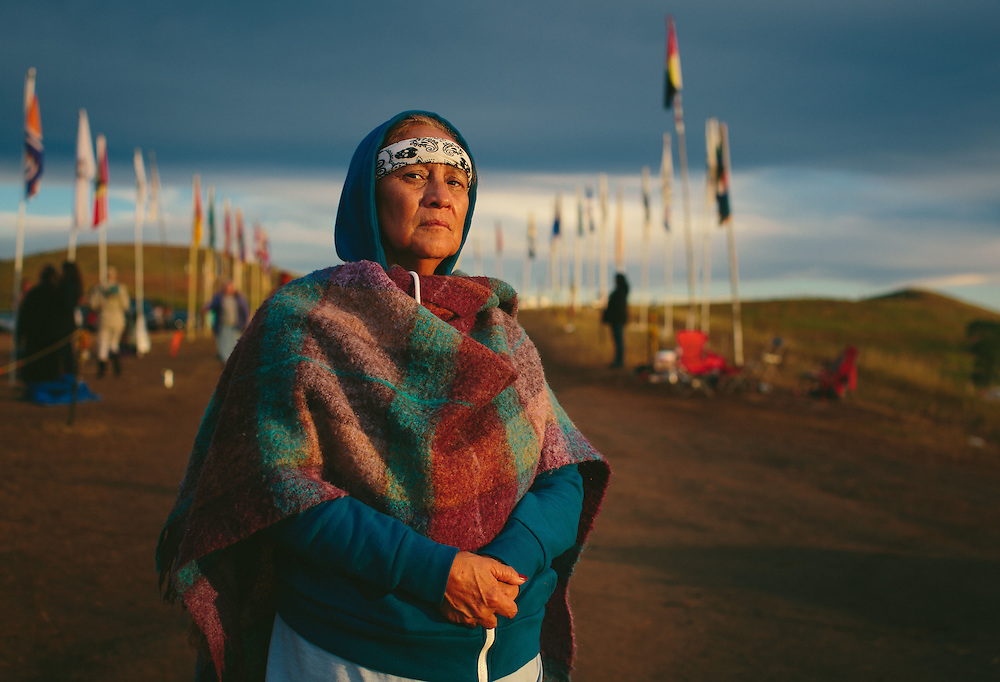 Bismarck, North Dakota<br /> <br /> Shirley Romero Otero is a Chicana activist from San Luis, the oldest indigenous community in the state of Colorado. An heir to the Sangre de Cristo Land Grant, her community is dealing with its own fight for water. &quot;When we heard about this particular struggle, our hearts pulled us this way because the next battle after losing our land is truly the fight for water,&quot; she said.<br /> <br /> -- <br /> <br /> When visitors turn off a narrow North Dakota highway and drive into the Sacred Stone camp where thousands have come to protest an oil pipeline, they thread through an arcade of flags whipping in the North Dakota wind. Each represent one of 280 Native American tribes that have flocked here in what activists are calling the largest, most diverse tribal action in at least a century, perhaps since Little Bighorn.