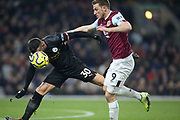 Burnley forward Chris Wood (9) and Manchester City defender Nicolas Otamendi (30) fight for possession  during the Premier League match between Burnley and Manchester City at Turf Moor, Burnley, England on 3 December 2019.