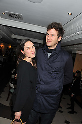 ISAAC FERRY and TALLULAH HARLECH at a party hosted by TopShop to celebrate 10 years of NEWGEN and 10 years of supporting Brtish Fashion held at Le Baron, 29 Old Burlington Street, London W1 on 21st February 2012.