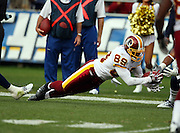 Washington Redskins wide receiver Santana Moss (89) dives and catches a second quarter pass during the NFL football game against the San Diego Chargers, January 3, 2010 in San Diego, California. The Chargers won the game 23-20. ©Paul Anthony Spinelli