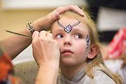 Jordan Gosney, 5, of Falmouth, Ky., gets her face painted at the Sibs Carnival in Baker on February 6, 2016. Photo by Emily Matthews