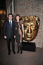 PADDY BYNG Managing Director of Asprey and AMANDA BERRY chief executive of BAFTA at the BAFTA Nominees party 2011 held at Asprey, 167 New Bond Street, London on 12th February 2011.