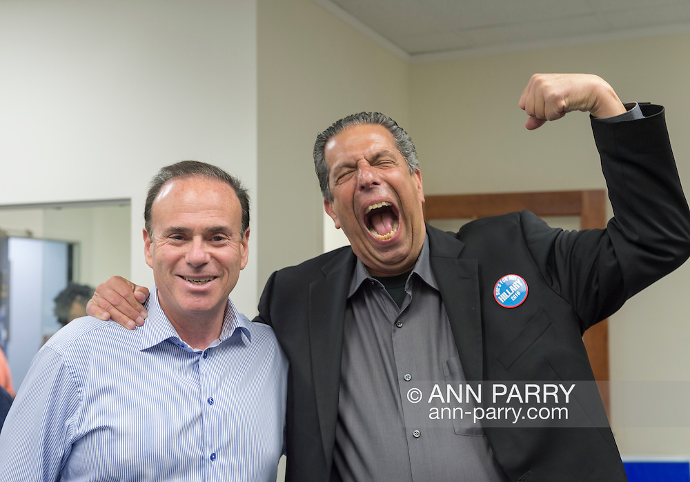 Garden City, New York, USA. April 17, 2016. R-L, JON BAUMAN, 'BOWZER', 69, singer in the band Sha Na Na, poses with JAY JACOBS, the Nassau County Democratic Chairman, at the Canvass Kickoff for Democratic presidential primary candidate Hillary Clinton at the Nassau County Democratic Office. In his Bowzer character's signature pose, Bauman lifted his arm and spoke in low voice. At the event, Bauman autographed photos of himself as Bowzer for the volunteers and spoke about why it's important to GOTV, Get Out The Vote for Hillary Clinton. Bauman is an activist in electoral politics and public policy activist and co-founded Senior Votes Count, which focuses on senior issues.