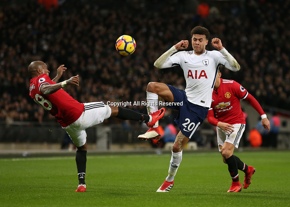 31st January 2018, Wembley Stadium, London England; EPL Premier League football, Tottenham Hotspur versus Manchester United; Ashley Young of Manchester United puts pressure on Dele Alli of Tottenham Hotspur