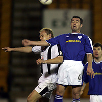 St Johnstone v St Mirren..18.12.04<br />David Hannah beats Mixu Paatelainen<br /><br />Picture by Graeme Hart.<br />Copyright Perthshire Picture Agency<br />Tel: 01738 623350  Mobile: 07990 594431