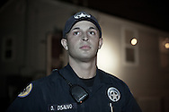 New Orleans, December 31, 2011, 23 year old police officer, David DeSalvo , with the 5th District Power Squad, a specialized unit that patrols the city's toughest neighborhoods at work on New Year's Eve. New Orleans murder rate is among the highest in America and is considered to be one of the most dangerous cities in the world.